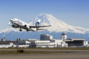 Alaska Airlines 737 taking off from Sea-Tac Airport with Mt Rainier and Central Terminal in background. Photo: Port of Seattle by Don Wilson