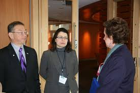 Conrad Lee, deputy mayor of Bellevue, Wash., and then Bellevue Senior Policy Advisor Sheida R. Sahandy (center), chat with GSA Administrator Martha N. Johnson about how their city has used electric vehicle charging stations. Photo courtesy  gsa.gov.