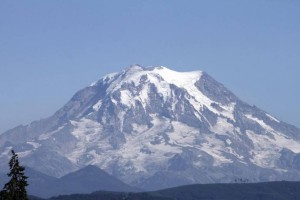 The impact of the record heat and lack of precipitation has made Mount Rainier much less snow covered in recent years. LEE GILES III Puyallup Herald file