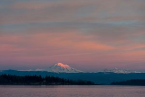 Winter sunset alpenglow on Mt Baker and the North Cascades. Copyright: LoweStock